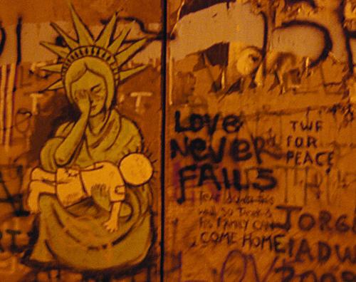 "Separation wall graffiti, ""Lady Liberty"" cries over a dead child - Derek Smallwood"